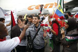 Palestinian students arrive at Simon Bolivar airport outside Caracas