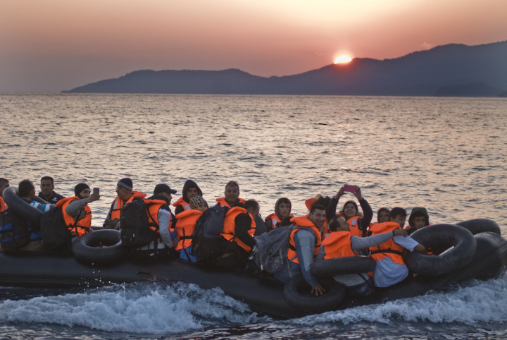 October 4,2015-Lesvos, North-east Aegean sea, Greece: Refugees arrive into a small plastic and cheap boat to the coast of the Greek island Lesvos from the Turkish land (Maro Kouri)