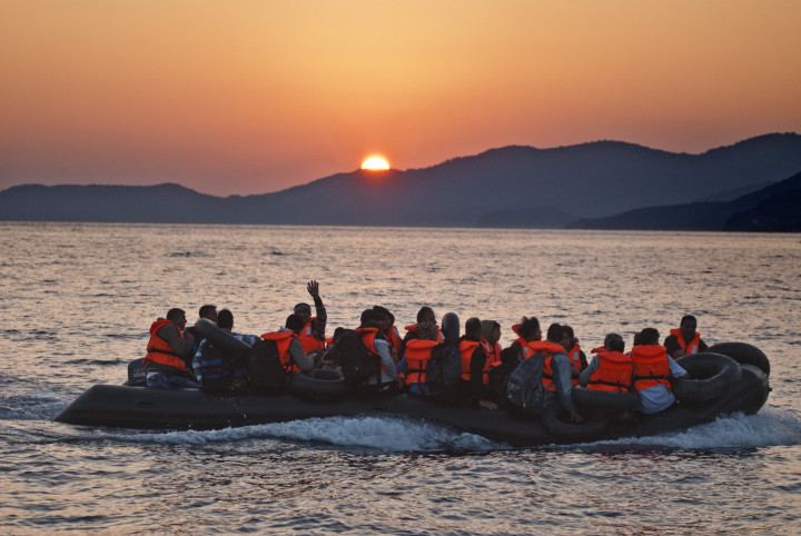 October 4,2015-Lesvos, North-east Aegean sea, Greece: Refugees arrive by a small plastic and cheap boat to the coasts of the Greek island Lesvos from the Turkish land (photo by Maro Kouri)