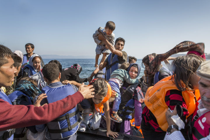 Refugees arrive on there Greek island of Lesbos having crossed the Mytilini straits from Turkey in an inflatable boat. ; Since the beginning of August huge numbers of refugees, many of them hailing from Syria and Afghanistan have been crossing the Aegean sea from Turkey to Greece. The Island of Lesbos is the main landing point and thousands of people are now clogging the Islands' main cities and ports as they look for ways to continue their journey onto the mainland and towards the Balkans. The crossings are fraught we danger as boats are overloaded and usually captain-less.