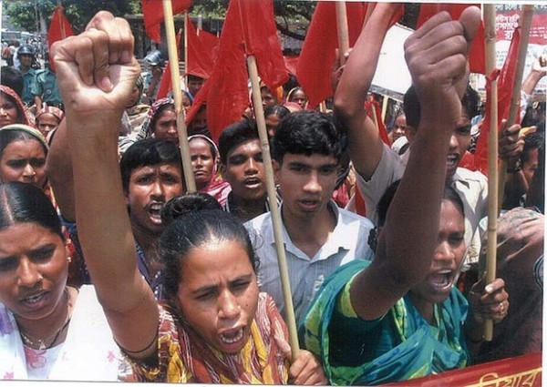 Hundreds of Bangladesh garment factories shut down as women take to streets in Dhaka