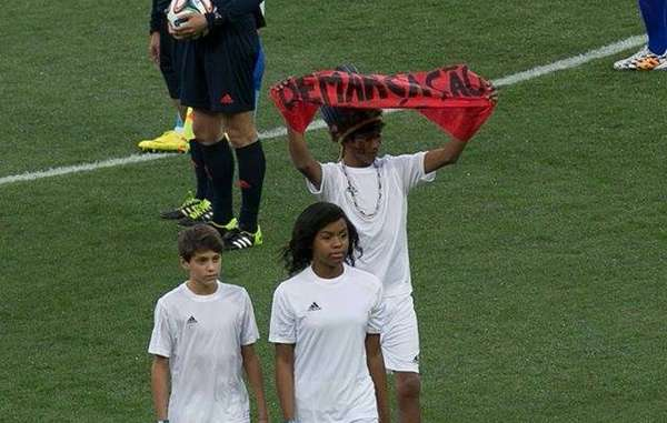 Indigenous boy protests on pitch during World Cup opening ceremony