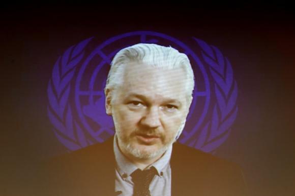 Assange demands rape case files before Sweden questions him
