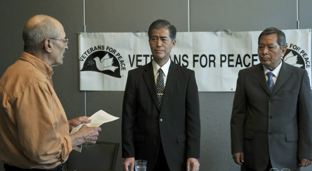 Tarak Kauff presents the Veterans For Peace letter to Okinawan officials