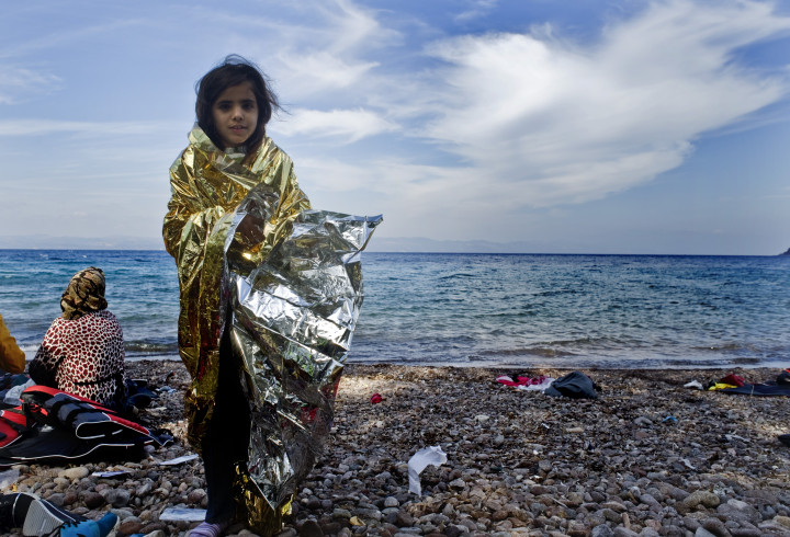 October 5, 2015-Lesvos, North-east Aegean sea, Greece: Children refugees arrive into a small plastic and cheap boat to the coast of the Greek island Lesvos from the Turkish land (Maro Kouri)