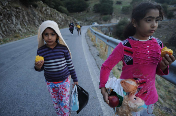 October 4, 2015 - Lesvos, Greece: Refugees children walk for hours  more than 30 km in order to find shelter in a camp. Thousands of refugees arrive to Lesvos coasts in plastic -and not safe- boats from the turkish coasts in order to travel towards north Europe (Maro Kouri)