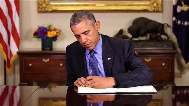 Obama signs executive order lifting Iran sanctions