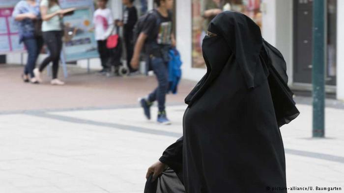 Fewer burqas, more police