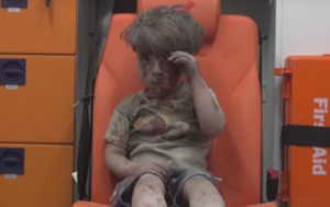 The Syrian boy in the ambulance breaks my heart. But what can I do?!