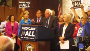 The Neoliberal Assault on Warren's Plan to Pay for Medicare for All