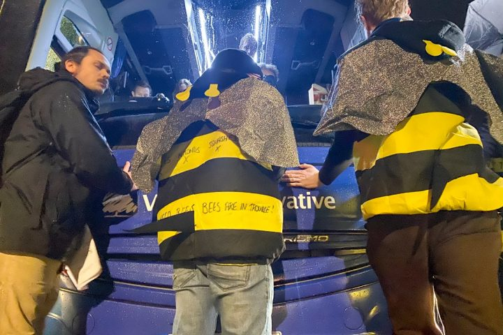 Extinction Rebellion UK glue themselves to Tory battle bus