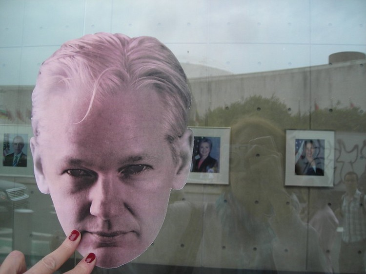 Credit: Pamela Drew | Julian Assange Outside & Hillary Clinton Inside State