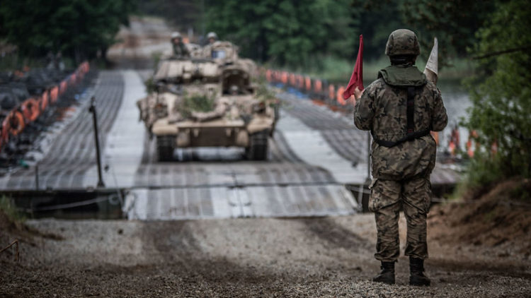A US Army Bradley fighting vehicle crosses a Polish floating bridge at Zły Łęg lake during Exercise Allied Spirit. Part of DEFENDER-Europe 20 Plus, Allied Spirit brings together more than 6,000 Polish and US Army troops for combat and mobility drills.