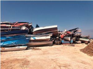 """Il cosiddetto """"Cimitero delle barche"""" a Capo Ponente. Qui sono ammassate le barche sequestrate. Altri due depositi di barche sono stati distrutti in un incendio doloso il 6 giugno scorso."""