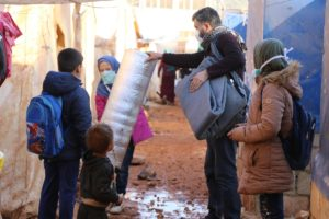 Floods in Syria. Still I Rise distributes blankets, tarps and mats to support its students