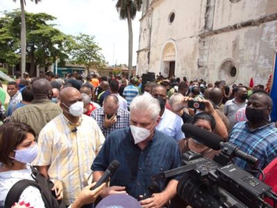 Cuban President Díaz-Canel speaking to reporters after marching on the streets