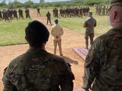 US Special Operations forces and Mozambican marines look on as US Special Operations Command Africa Deputy Commander Colonel Richard Schmidt speaks during a ceremony to launch a joint military training program in Maputo, March 15, 2021, to help Mozambique counter the al-Shabaab insurgency in the Cabo Delgado region.