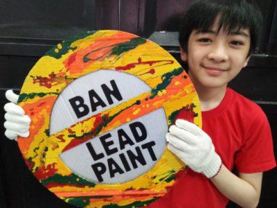 Child holding ban lead paint signage 3