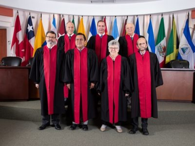 Current members of the Inter-American Court of Human Rights, composed of (left to right) jurists from Argentina, Mexico, Uruguay (background) and Colombia, Ecuador, Costa Rica and Chile (foreground).