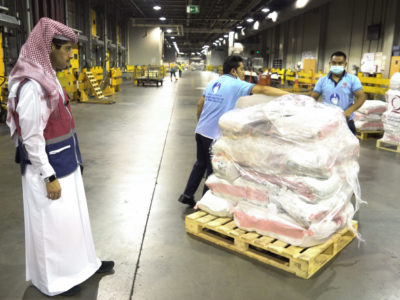 Officials unload packages of Qatari humanitarian aid in Kabul on Sept. 17, 2021